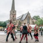 Morris dancers opposite the church.