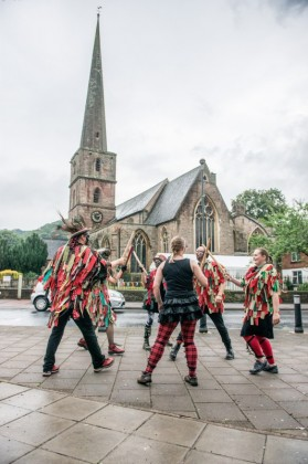 Morris dancers opposite the church.